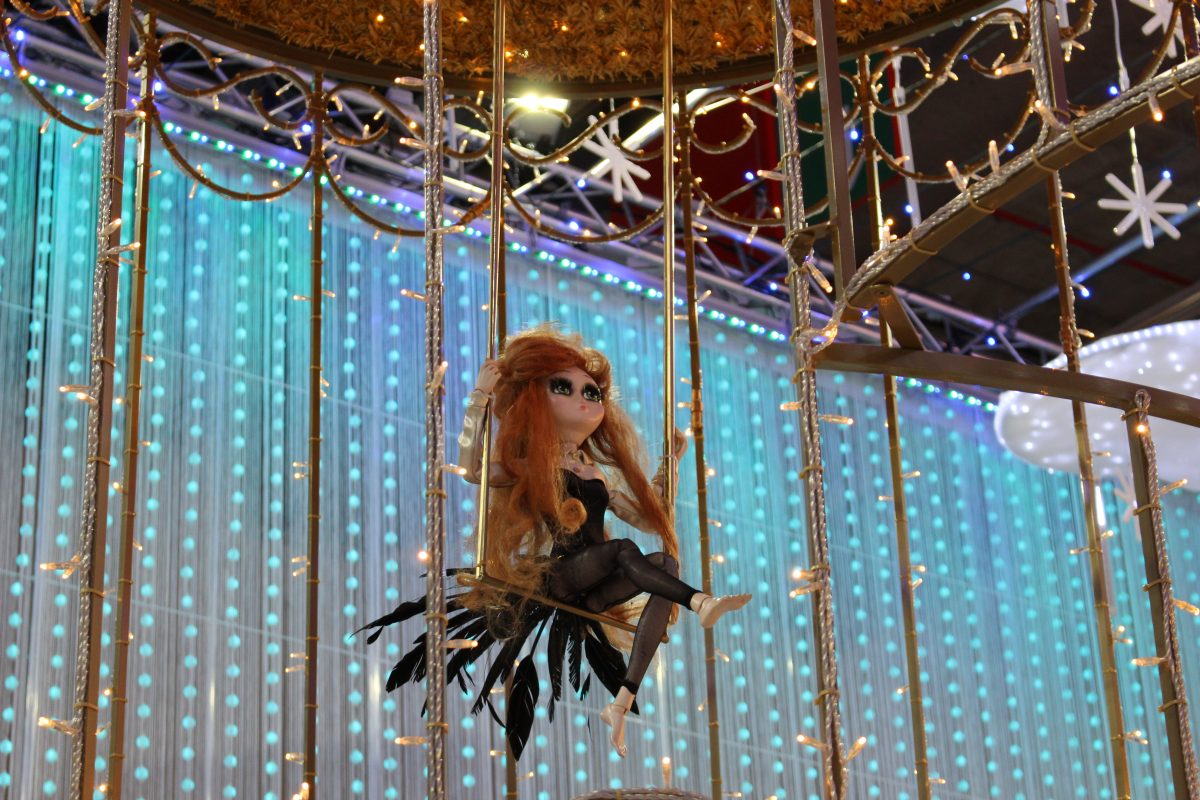 Doll on a swing